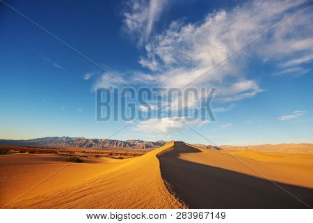 Sand dunes in Death Valley National Park, California, USA. Living coral toned.
