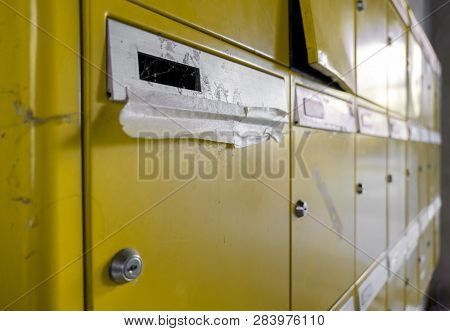 Old Disused Yellow Mailboxes. Ideal For Concepts And Backgrounds.