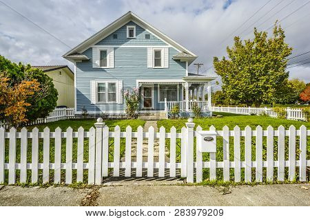Spokane, Washington - October 1 S018: A Typical Quaint Victorian Home With A White Picket Fence In T