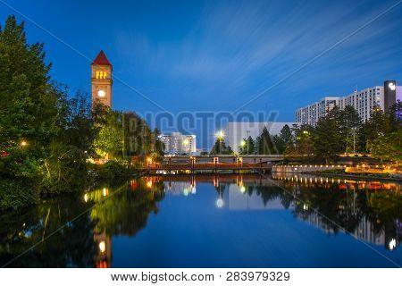 Spokane, Washington - September 2 2018: Evening On The Spokane River With The Clock Tower, Bridge An