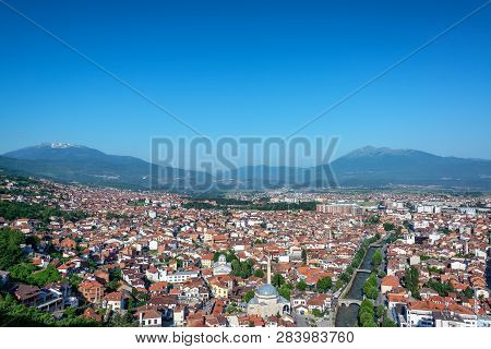 Beautiful cityscape view of Prizren, Kosovo with the Albanian Alps rising in the background poster
