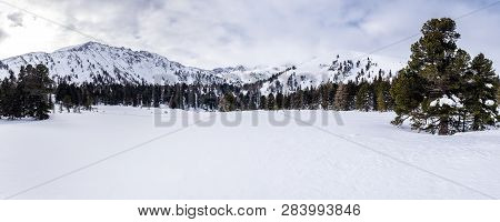 Panoramic View From Snow Covered Scheibelalm In Holiday Resort Hohentauern To Mountains Großer Hengs