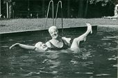Vintage photo of mother and daughter in swimming pool (sixties)