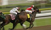 Abstract motion blur of racing jockey leading the field in a thoroughbred horse race. poster