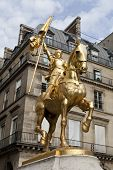 The golden statue of Saint Joan of Arc in Paris, France. poster