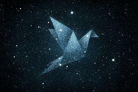 Stars In Origami Bird Shape Over Blue Night Sky Background