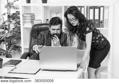 Internet Surfing. Business Couple Work On Computer In Office. Employees Deal With Computer Problem.
