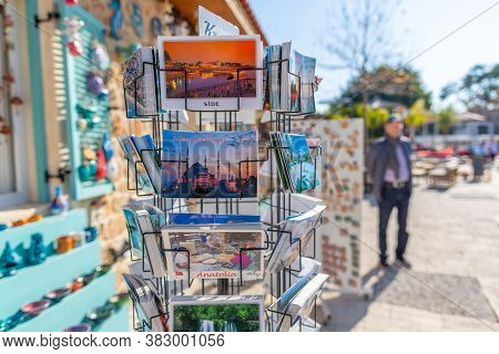 Antalya / Turkey - January 19, 2020: Postcards In A Postcard Holder In Front Of A Souvenir Shop