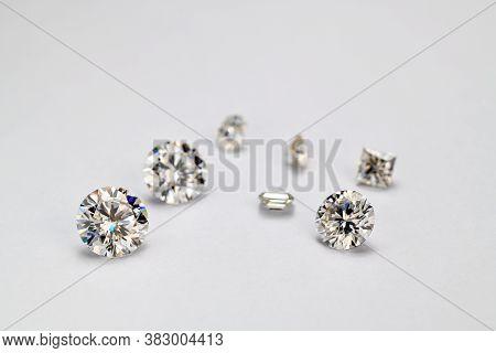 Diamonds On A White Background. Round Cut Gemstones