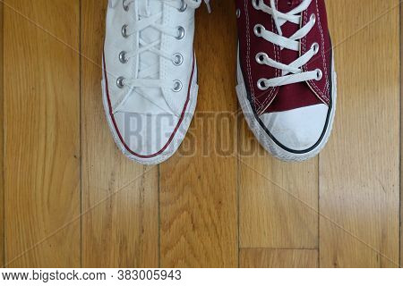 Odd Shoes, One Red And One White Canvas Sneaker