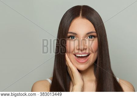 Happy Young Woman Spa Model With Clear Skin And Long Healthy Straight Hair. Skincare And Facial Trea