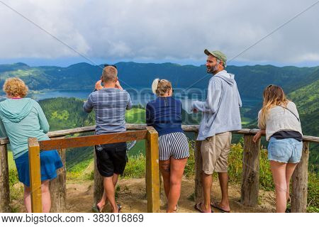 Sao Miguel, Azores island, Portugal, August 14, 2020: People at the Lake of Sete Cidades, a volcanic crater lake on Sao Miguel island, Azores, Portugal. View from Boca do Inferno