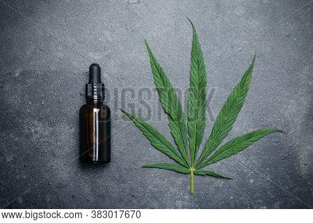 Cannabis Oil (cannabidiol).  Medical Cannabis (marijuana) And Extract сbd On Dark Background.