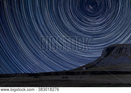 Digital Composite Image Of Star Trails Around Polaris With Landscape Of Norber Ridge In Yorkshire Da