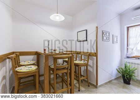 Modern Interior Detail Of Corner Dining Table