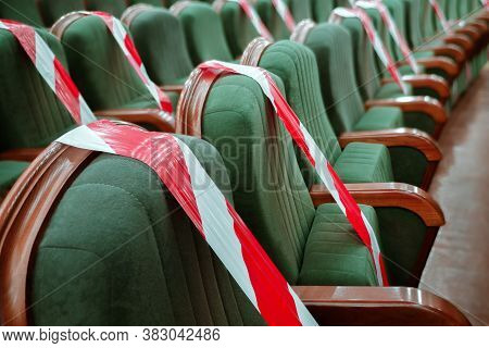 Background Of Empty Seats In The Cinema, Theater, Auditorium With A Warning Label. Presentation Of A
