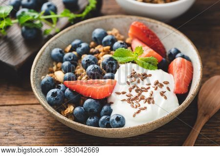 Healthy Breakfast Food With Greek Yogurt, Crunchy Oat Granola And Fruits On A Wooden Table. Sustaina