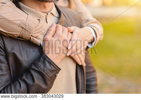 Love, Affectionate Concept. Female Hands Hugging Man From Behind, Park Background, Copy Space