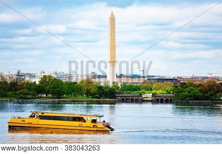 National Mall Washington Monument Obelisk Over Potomac River With Passing By Yellow Boat