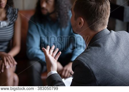 Close Up Psychotherapist Expert Consulting African American Couple At Meeting