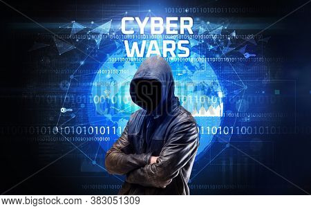 Faceless hacker at work with CYBER WARS inscription, Computer security concept
