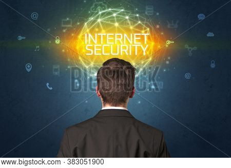 Rear view of a businessman with INTERNET SECURITY inscription, online security concept