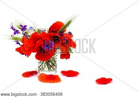 Red Poppies, Cornflowers, Ears Of Green Wheat, Chamomile In Small Vase On White Background With Spac