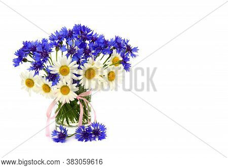 Chamomiles And Cornflowers In Small Vase With Ribbon On White Background With Space For Text