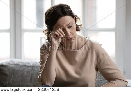 Stressed Middle Aged Woman Worrying About Hard Life Situation.