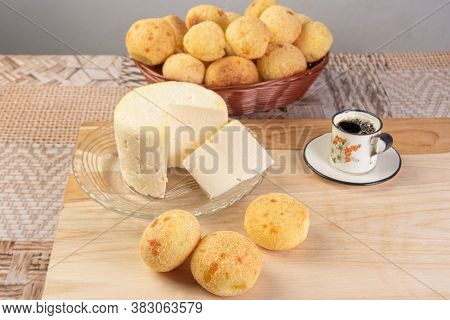 Minas Cheese, Cup Of Coffee And Cheese Bread From Brazil, Arranged On A Table With Beige Tablecloth