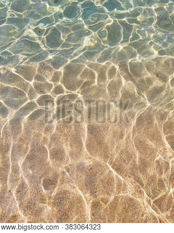 Clear Sea Water, Very Small Pebbles At The Bottom