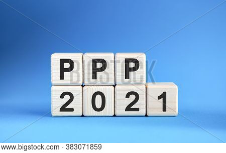 Ppp 2021 Years On Wooden Cubes On A Blue Background