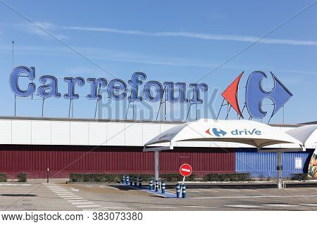 Creches, France - March 15, 2020: Carrefour Hypermarket And Drive. Carrefour Is A French Multination