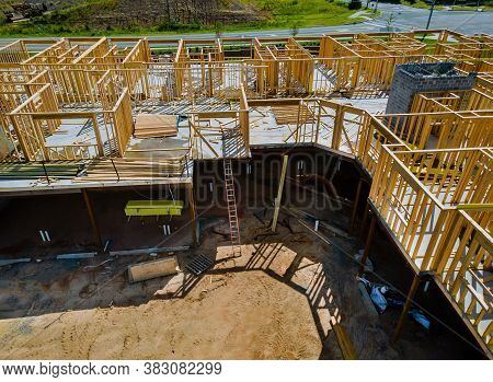 Wooden Frame Structure House Building On A New Development Framing Of Under Construction