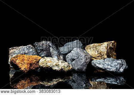 Various Raw Ore Gemstones Or Rocks On Black Background, Mining And Geology, Mineralogy