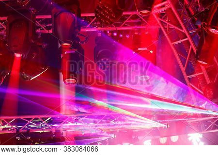 Modern Stage Lighting Equipment At A Concert. Led Moving Heads, Lasers, And Other Lighting Fixtures