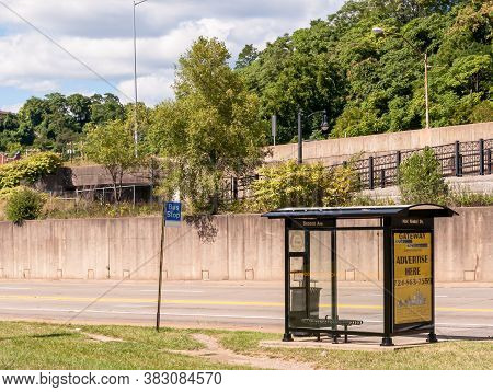 Pittsburgh, Pennsylvania, Usa 8/30/20 An Empty Allegheny County Port Authority Bus Shelter And Sign