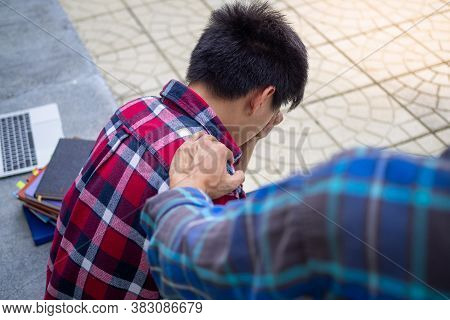 The Hand Touching The Shoulder Showed Encouragement After The Male Students Were Disappointed With T