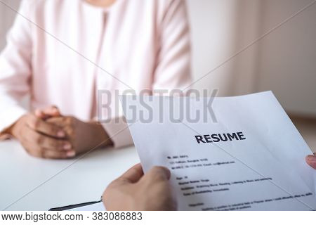 Executives Holding The Resume Of The Applicant. Business People Interview Job By Asking About Their