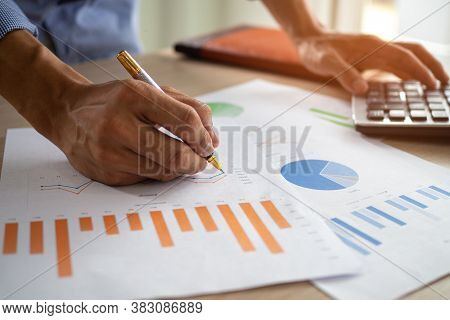Business Men Looking At Charts, Spreadsheets, Graph Financial Development, Bank Accounts, Statistics
