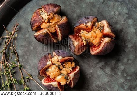 Figs Stuffed With Goat Cheese. Figs With Nut And Honey Cheese. Shallow Dof. Figs With Nut. Blue Chee