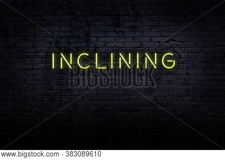 Neon Sign On Brick Wall At Night. Inscription Inclining