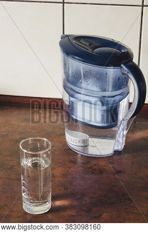 Water Filter Jug With Silicon Cartridge Inside On The Kitchen Counter. Silicon Cartridge For Saturat