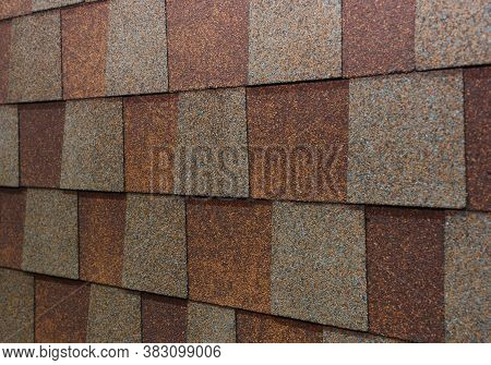 A Close-up On Brown And Gray Asphal Roof Shingles When Choosing The Right Roof Shingle Color.