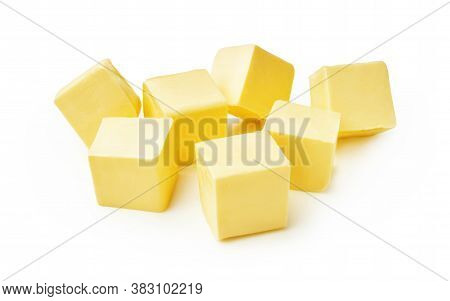Pieces Of Butter Isolated On White Background. Butter Cubes.