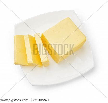 Sliced Butter Of Piece Butter On White Plate Isolated. Top View.