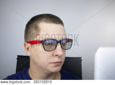 The Programmer's Glasses Reflect Lines Of Code. Programming, Development Of Applications, Sites And