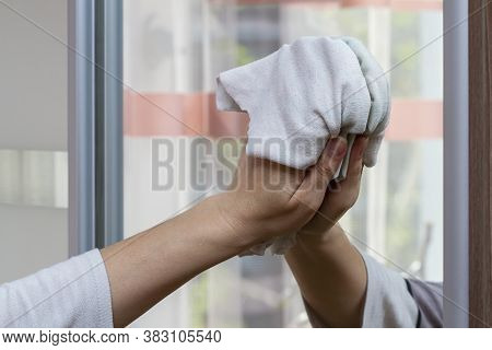 Hand Of Girl Wipes A Mirror With A Rag At Home