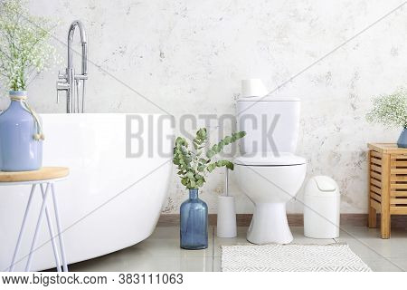 Interior Of Modern Bathroom With Floral Decor