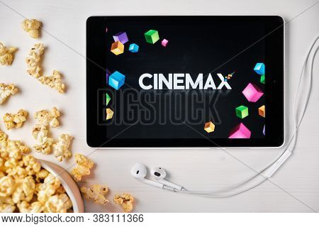 Cinemax Logo On The Screen Of The Tablet Laying On The White Table And Sprinkled Popcorn On It. Augu